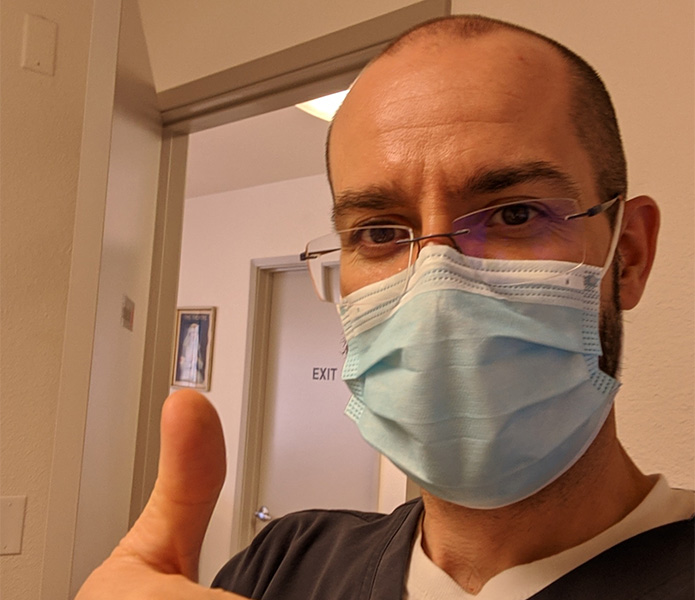 Dr. Dzvonick wearing mask at California Naturopathic Clinic