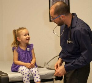 Dr. Bryan Dzvonick with a pediatric patient